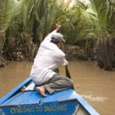 En sampan dans le Delta du Mékong
