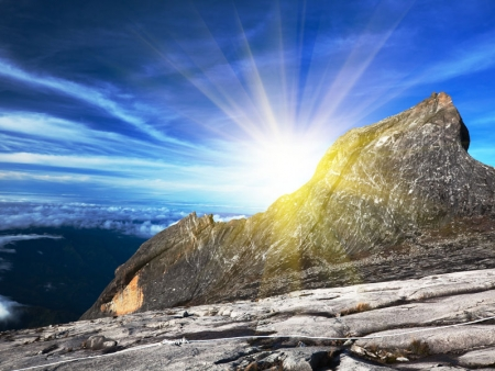 At the top of Kinabalu, 4,095 meters (13,435 feet), above the clouds...